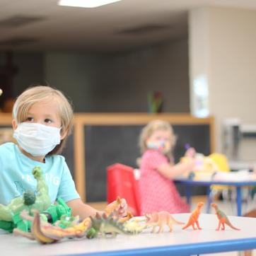 Pre-k with masks and dinsaur